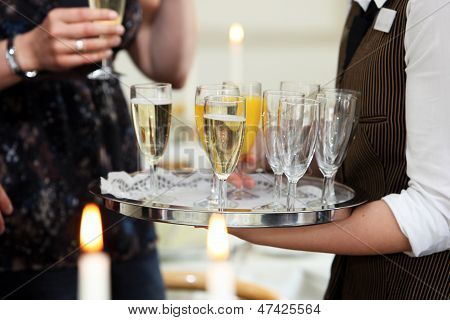 Waiter Serving Champagne And Orange Juice
