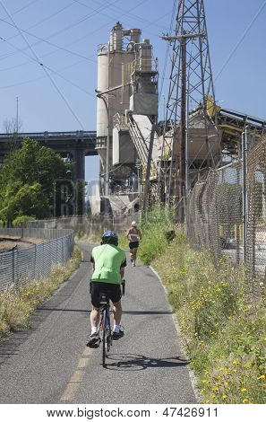 Runner And A Biker On Portland's New Springwater Corridor