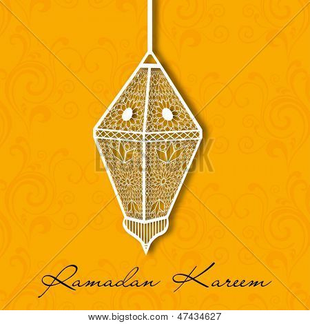 Muslim community holy month of Ramadan Kareem background with hanging intricate arabic lantern on orange background.