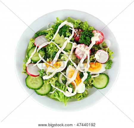Fresh mixed salad with eggs, salad leaves and other vegetables, isolated on white