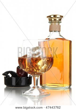 Brandy with ice and cigar isolated on white