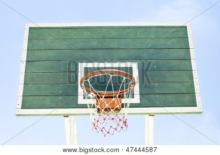 Wooden Green Basketball Hoop with blue sky