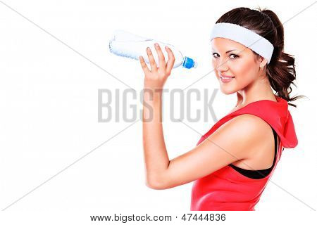 Sportive young woman drinking clear water after training. Healthcare. Isolated over white.