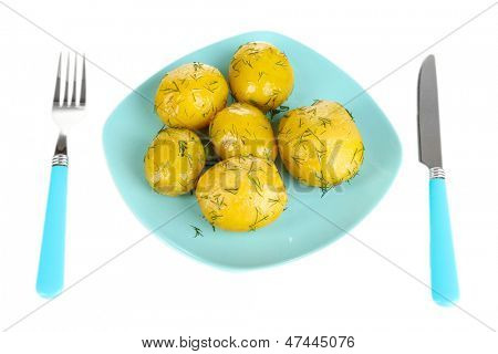 Boiled potatoes on plate isolated on white
