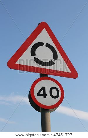 UK roundabout ahead and 40mph reminder signs