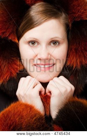 Woman Portrait In Fur Hood