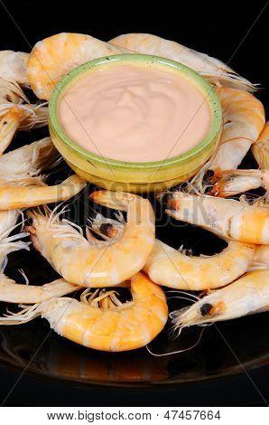 King prawns with seafood sauce.
