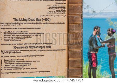 DEAD SEA, JORDAN - MAY 6: people applying dead sea mud body care treatment  on May 6 2013 , in Dead Sea Jordan
