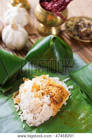 Nasi lemak Malay dish, popular traditional Malaysian food wrapped with banana leaf.