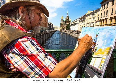 ST.PETERSBURG, RUSSIA - JUNE 22: Unknown artist paints the Church of the Savior on Spilled Blood, June 22, 2013, St. Petersburg, Russia. Church is one of the main sights of city, was built 1883-1907.
