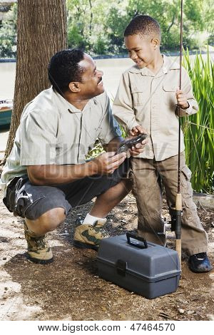 Father and son with fishing gear