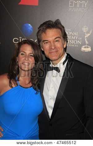 BEVERLY HILLS - JUN 16: Lisa Oz, Dr. Mehmet Oz at the 40th Annual Daytime Emmy Awards at The Beverly Hilton Hotel on June 16, 2013 in Beverly Hills, California
