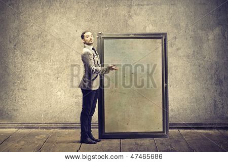 young man shows large frame