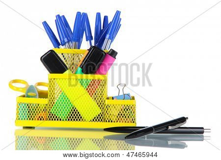 Office equipment in yellow stationary holder isolated on white