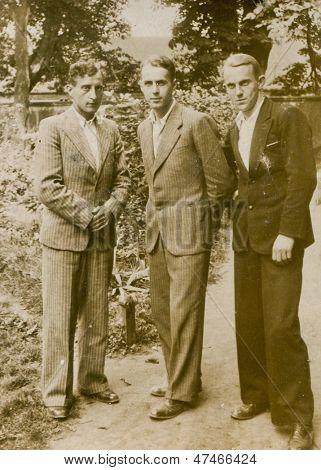 CZESTOCHOWA, POLAND, CIRCA 1934- vintage photo of three men in suits outdoor, Czestochowa, Poland circa 1934