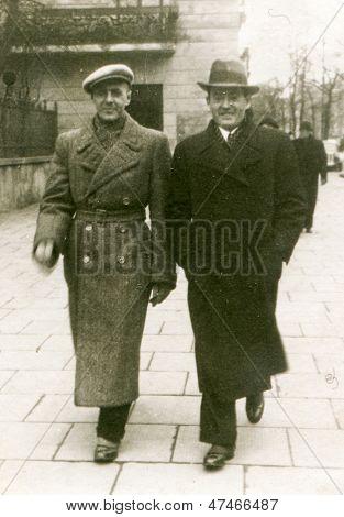 CZESTOCHOWA, POLAND, CIRCA 1939- vintage photo of two men in coats walking outdoor, Czestochowa, Poland, circa 1939