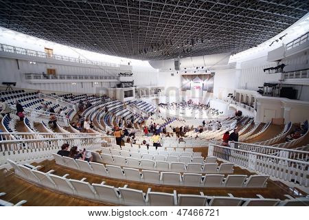 MOSCOW - SEPTEMBER 8: Spectators sit down on seats prior to IV Grand Festival of Russian National Orchestra in Tchaikovsky Concert Hall, on September 8, 2012 in Moscow, Russia.