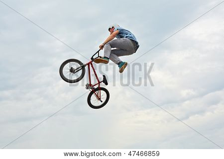 MOSCOW - AUG 4: Boy jumps on bike at All-Russian Exhibition Centre during holiday dedicated to 73d birthday of country main exhibition, August 4, 2012, Moscow, Russia.