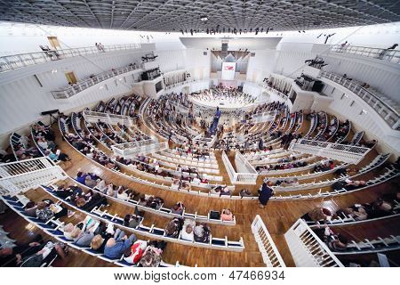 MOSCOW - SEPTEMBER 8: Above view of people sit down on seats prior to IV Grand Festival of Russian National Orchestra in Tchaikovsky Concert Hall, on September 8, 2012 in Moscow, Russia.