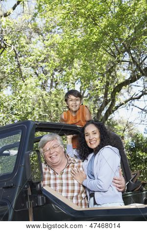 Grandparents with grandson in jeep