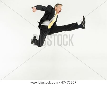 Full length portrait of a businessman jumping against white background