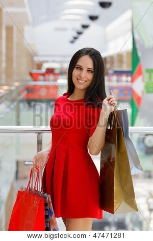 Young Woman Shopping in Mall with Shopping Bags