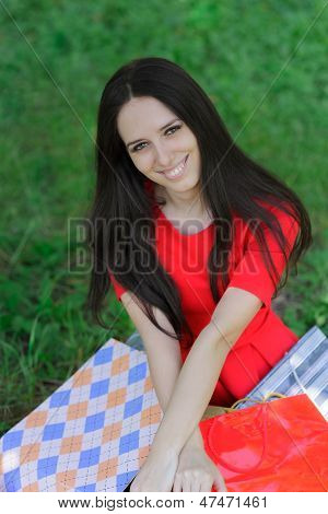 Young Woman with Shopping Bags and Grass