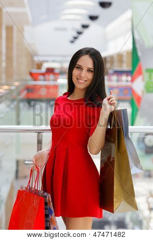 Young Woman Shopping in Mal with Shopping Bags
