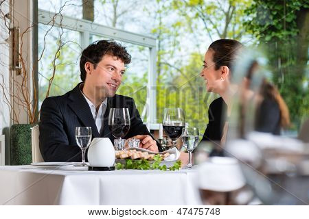 Businesspeople having business lunch in a fine dining restaurant