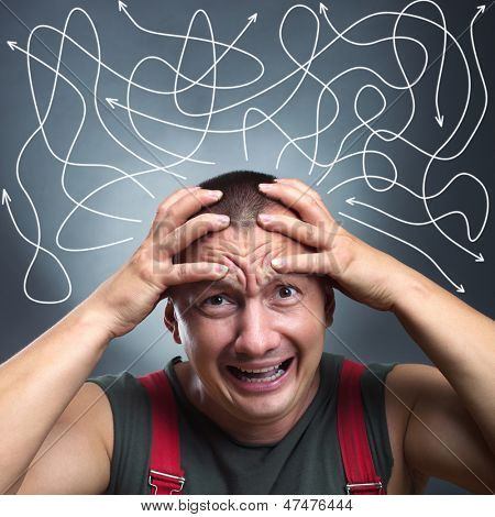 Portrait of stressed man with many arrows pointed in different directions