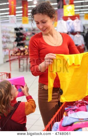 Mother With Daughter In Clothes Shop