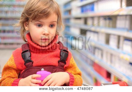 Girl  In Shop Of Household Cosmetics