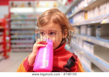 Girl In Shop With Plastic Bottle