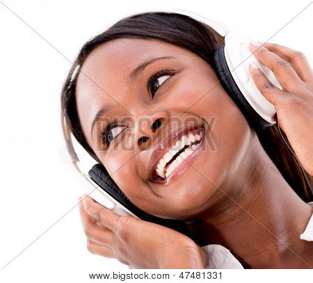 Woman listening to music with headphones - isolated over white background