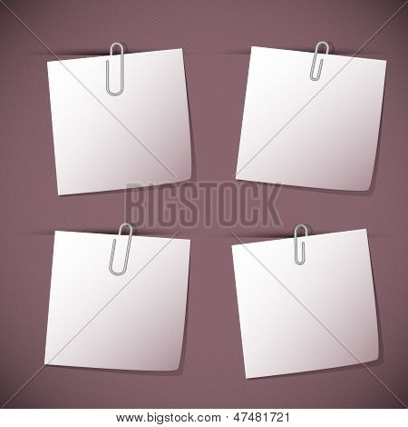 Note Papers With Paperclip On Violet Background