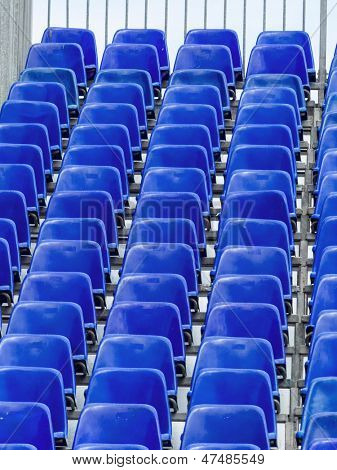 grandstand with blue chairs, symbolic photo for background, events, infrastructure