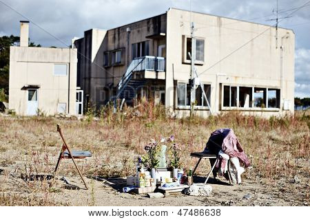 MATSUSHIMA, JAPAN - OCTOBER 29: A small shrine near a destroyed building October 29, 2012 in Matsushima, JP. The area was mostly destroyed in the 2011 Tohoku earthquake and tsunami.