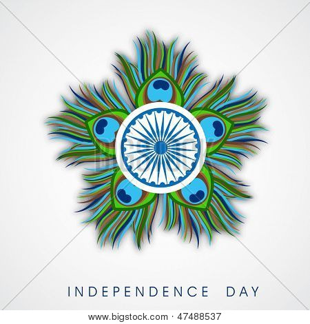 Beautiful Indian Independence Day concept with ashoka wheel and peacock feathers.