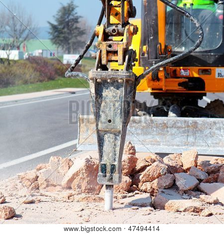 Jackhammer Working On The Road