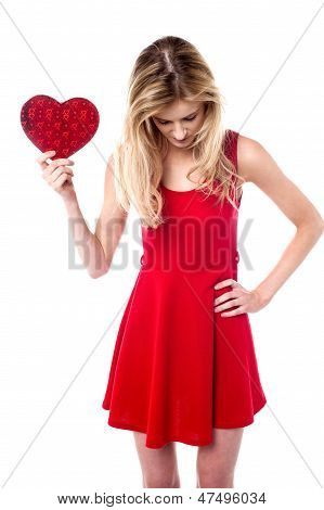 Girl Holding Valentine Gift Looking Down