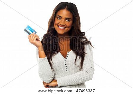 Young Woman Holding Up A Credit Card