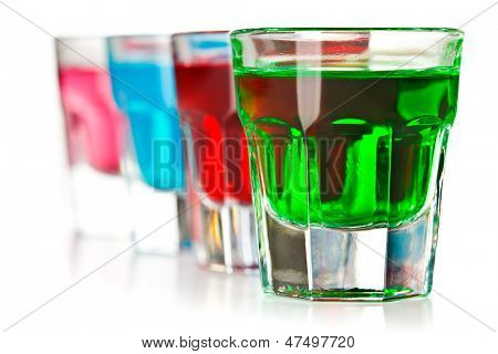 the various colorful liquors on white background