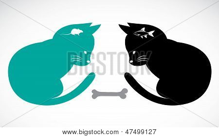 Two cats sitting looking food
