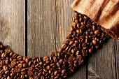 stock photo of coffee crop  - Coffee beans and bag over wooden background - JPG