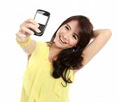stock photo of handphone  - smiling teenager girl take the picture her self with handphone - JPG
