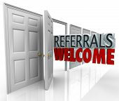 stock photo of encouraging  - The words Referrals Welcome coming out an open door to encourage customers to refer friends and family to your business - JPG