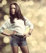 Casual Girl In Fashion Pose Bokeh Background