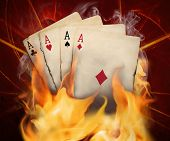stock photo of ace spades  - Poker cards burn in the fire  with studio lighting - JPG