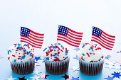 stock photo of patty-cake  - Patriotic holiday cupcakes decorated for july 4th - JPG