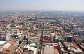 stock photo of smog  - Aerial view of Mexico City with traffic and smog - JPG